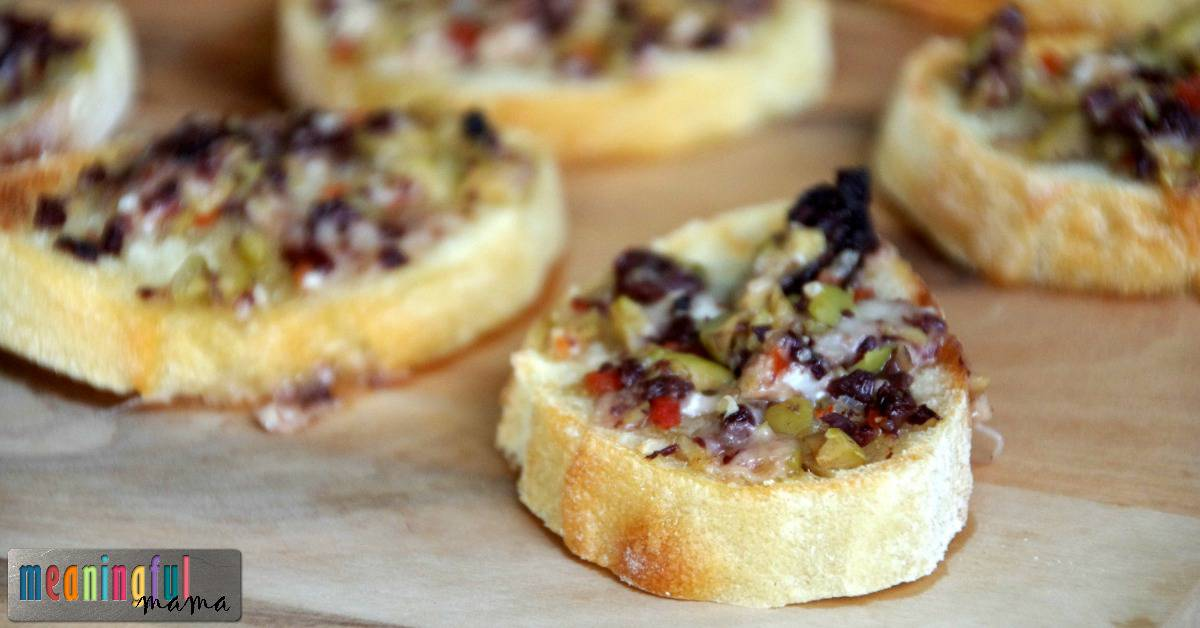 Cheesy Olive Tapenade Crostini - 10 Hot Appetizers Joyous Home